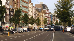 Time Lapse Zoom of Busy - Trams & People  - Amsterdam Netherlands Stock Footage