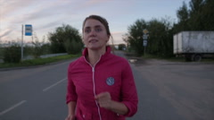 athletic girl on an evening jog - stock footage