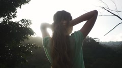 Long-haired woman Waves Her Hair in the Sunlight. Slow Motion - stock footage