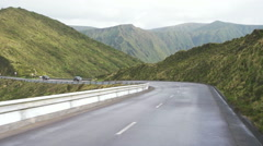 Ride on the Road in Between of Mountains Stock Footage
