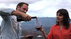Young couple pouring wine in the country mountain 240fps Stock Footage