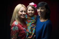 Latin mother with daughter and aunt - stock photo
