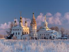 Winter view of the ensemble of ancient orthodox churches in Dymkovo Sloboda - stock photo