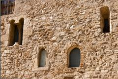 Facade with windows in the romanesque monastery of Sant Cugat - stock photo
