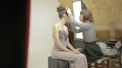 Makeup beauty process in studio Stock Footage