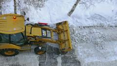 Tractor Cleans Road from Ice and Snow - stock footage