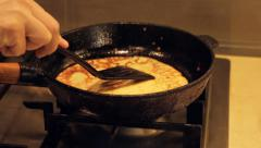 Crapes, pancakes cooking on cast iron pan - stock footage