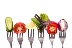 Fresh mixed vegetables on fork .healthy food Stock Photos