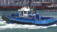 Tugboat works in Ports of Auckland New Zealand Stock Footage