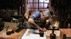 Man produces traditional woodblock printing textile in Rimini, Italy. Stock Footage