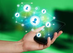 Finger pointing on smartphone, social network concept - stock photo
