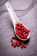 Goji berries,healthy superfood,diet concept , on black stone - stock photo