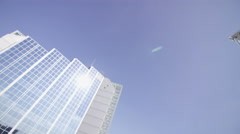 4K Low angle view looking up, modern city building and blue sky. No people.  Stock Footage