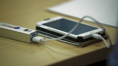Portable mobile charger, in work Stock Footage