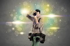 Photographer with flashing lights - stock photo