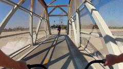 Bicycle Riding Across Bridge- San Gabriel River Trail Stock Footage
