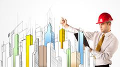 Stock Photo of Business person sketching a city sight