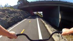 Bicycle Riding San Gabriel River Bikeway Under 405 Freeway Stock Footage