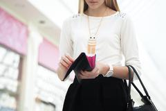 Young female hand holding opened wallet, close-up - stock photo