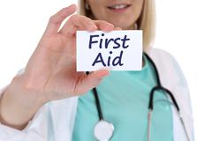 First aid help helping cpr doctor nurse medical accident - stock photo