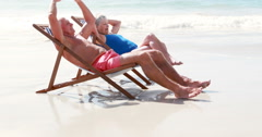 Retired old couple lying on deckchair Stock Footage