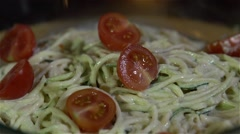 Zucchini noodles with tomato Stock Footage