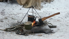 On the fire to cook the porridge and tea Stock Footage