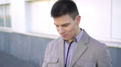 Young businesman using the smartphone Stock Footage
