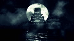 A Traditional Japanese Castle in the Middle of the Sea on a Night with Full Moon Stock Footage