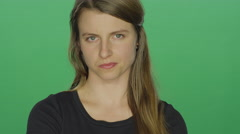 Women looks upset and shakes her head, on a green screen background Stock Footage