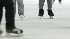 A lot of skates glide across the ice. Slow motion. Stock Footage