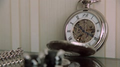Pocket watch on table time lapse - stock footage