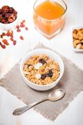 Granola, honey, nuts and raisins - stock photo