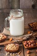 Vegan milk from nuts in glass jar Stock Photos