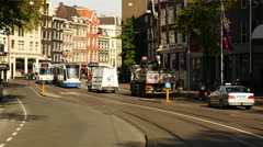 Trams & Traffic on a Busy Street in Amsterdam Netherlands Stock Footage