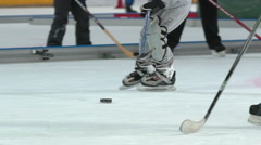 Young hockey players on the indoor ice rink at the ice Palace. Slow motion. Stock Footage