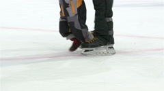 Sports family. Skates glide across the ice. Close Up. Slow motion. Stock Footage