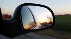 Driving View looking through side mirror Stock Footage