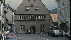Munster, France 1977: people walking in front of Hotel de Ville Stock Footage