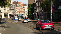 Time Lapse of Trams, Traffic & People on a Busy Street in Amsterdam Netherlands - stock footage