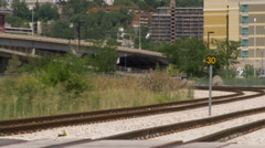 Urban train passing as it rolls away from the camera. Stock Footage