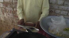 Man Frying Chapati Stock Footage