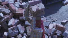 Women Laborer carrying bricks on head - stock footage