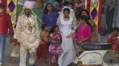 India wedding party walking through street Stock Footage