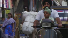 Sikh man and boy on motorcycle Stock Footage