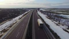 Aerial view of truck moving on highway. Winter. Stock Footage