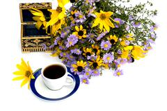 Still life beautiful casket, coffee and bouquet of flowers Stock Photos