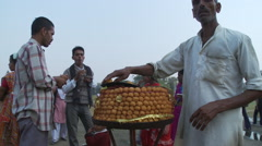 Man selling food from stand Stock Footage
