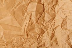 Crumpled and creased sack kraft paper texture - stock photo
