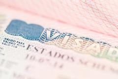 Fragment of Schengen visa in the passport - stock photo